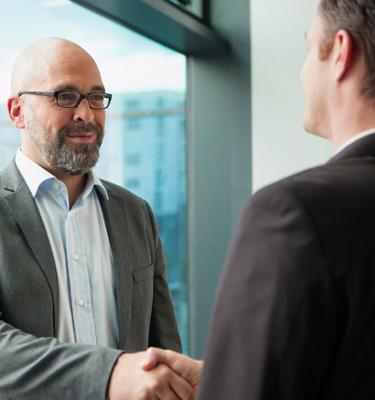 Executives handshaking
