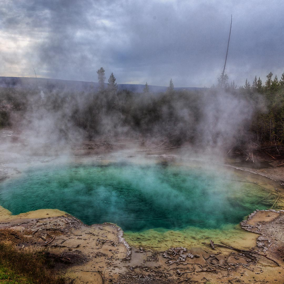 Hot springs with steam rising up