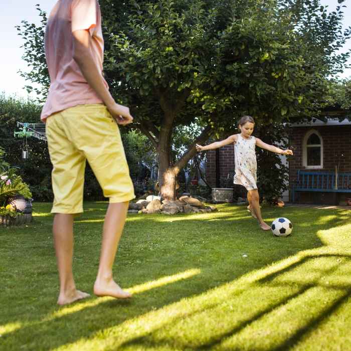 Playing soccer in eco-friendly backyard