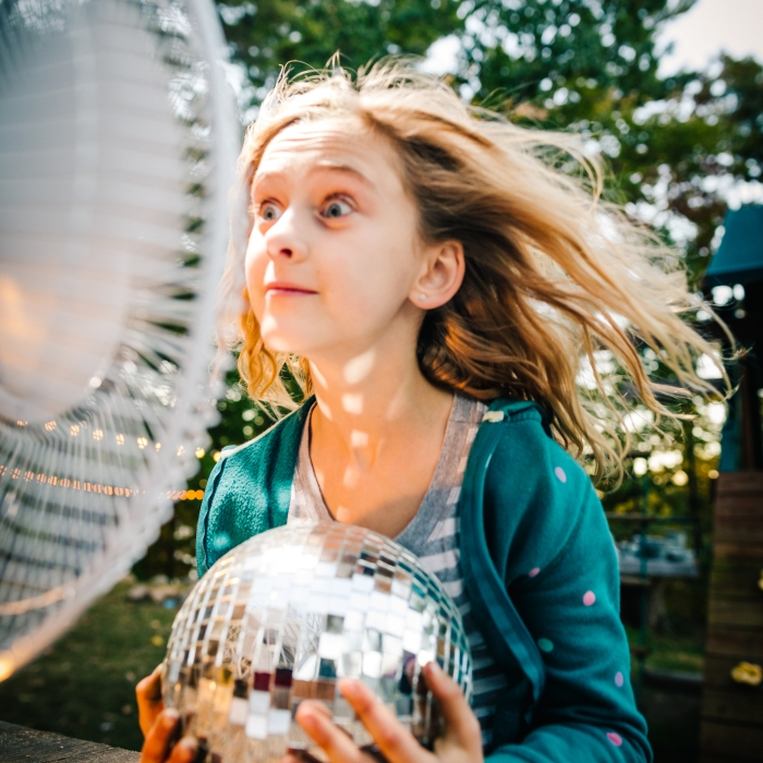 Girl staying cool with fan
