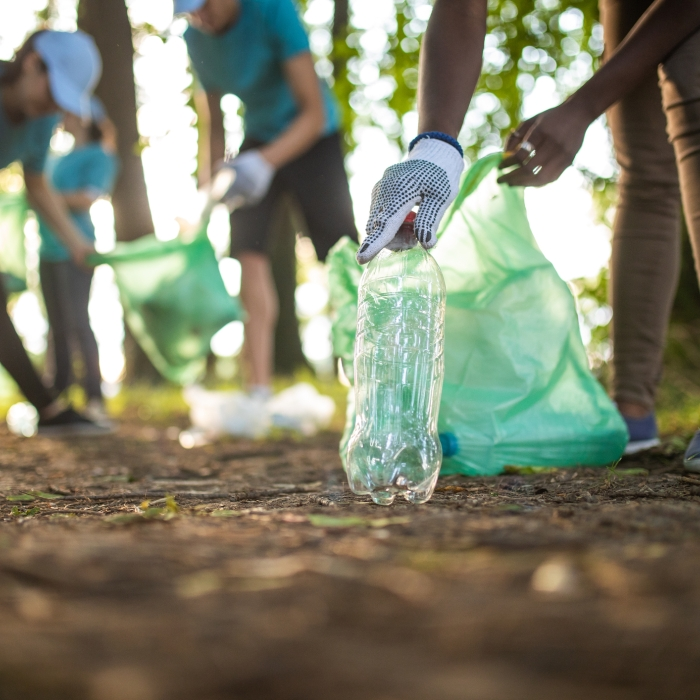 Volunteers picking up bottles to recycle them on Earth Day.