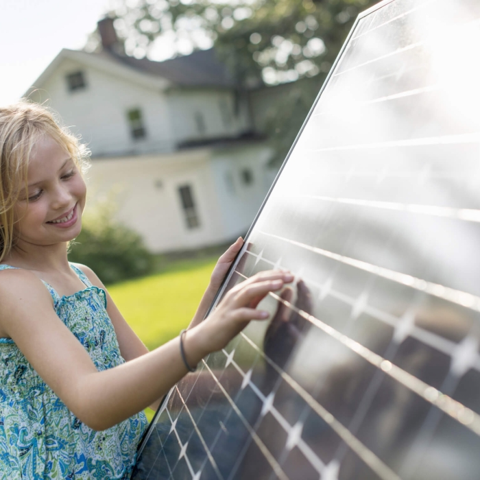 girl admiring solar array
