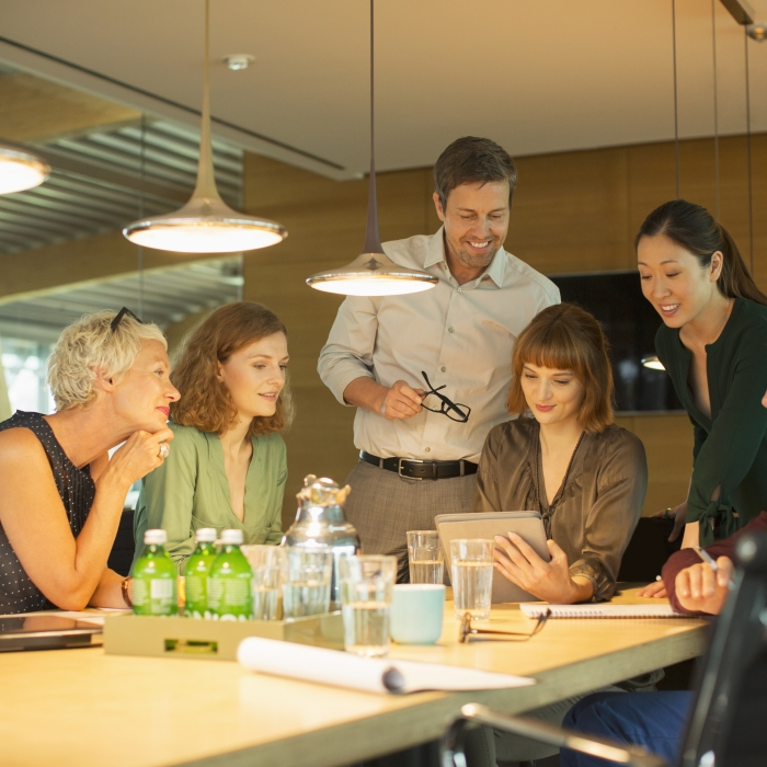 business team discusses project with led lighting