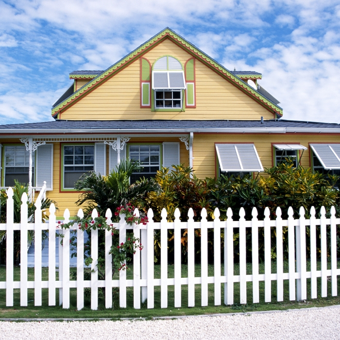 yellow home with Bahama shutters